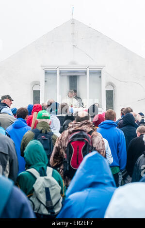 Pilgrims gather for mass at St. Patrick's church, at the top of Croagh Patrick, Ireland - Stock Photo