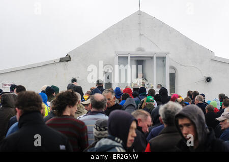 Pilgrims gather at St. Patrick's Chapel at the top of Croagh Patrick for mass during Reek Sunday. - Stock Photo