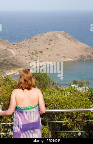 A young woman looks out over Anse Toiny in St. Barts - Stock Photo
