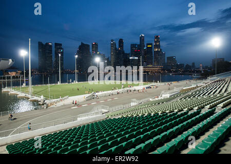 A view over the grandstand and Marina Bay towards the financial district of Singapore - Stock Photo