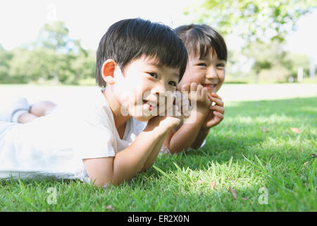 Happy Japanese kids in a city park - Stock Photo