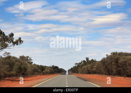 straight long boring road in  the outback of Australia - Stock Photo