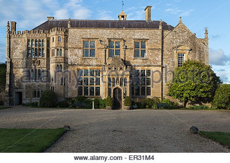 The West front of Brympton House with two large mullioned  windows flanking the principal entrance and a porch added - Stock Photo
