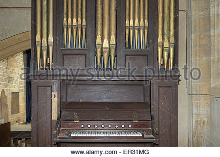 A hand-pumped pipe organ in St Andrew's Church set in the grounds of Brympton House. - Stock Photo