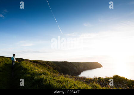 Pembrokeshire, Wales, UK. 24th May, 2015. A lone figure looks out to sea. Credit:  Dave Stevenson/Alamy Live News - Stock Photo
