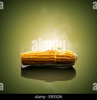 Cooked Ear of Corn with melting hot butter and steam - Stock Photo