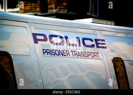 Police - Prisoner Transport sign on side of van - Stock Photo