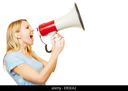 Young blonde woman screaming loudly into a big megaphone - Stock Photo