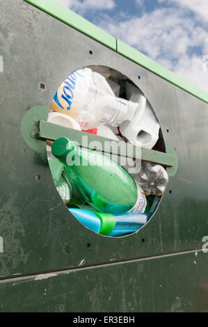 Overflowing entrance full up metal waste container for recycled plastic bottles containers squashed full - Stock Photo