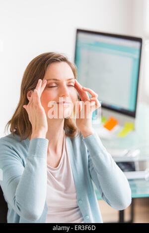 Facial exercise at work. - Stock Photo