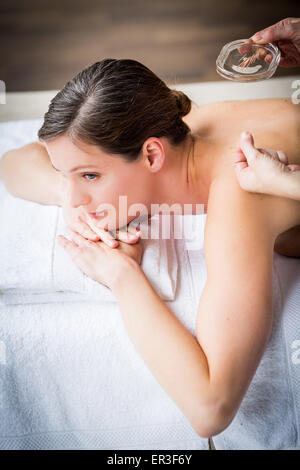 Woman receiving acupunture. - Stock Photo