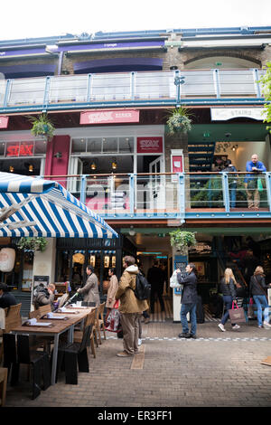 Kingly Court off Carnaby Street - Courtyard with Restaurants and Seating - london UK - Stock Photo