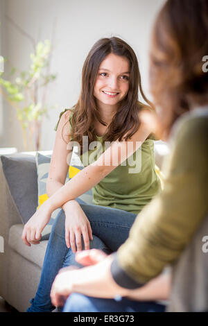 Woman discussing with a teenager.