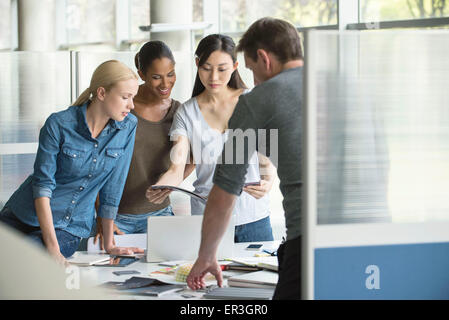 Colleagues selecting color swatches - Stock Photo
