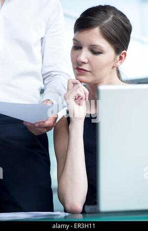 Colleagues collaborating in office - Stock Photo