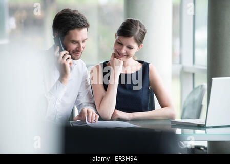 Business associates reporting good results - Stock Photo