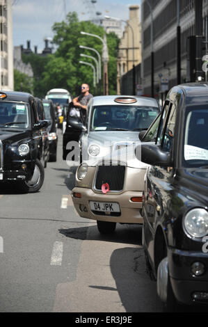 Westminster, London, UK. 26th May 2015. Hundreds of Black cab drivers bring Westminster to a halt in a demonstration - Stock Photo