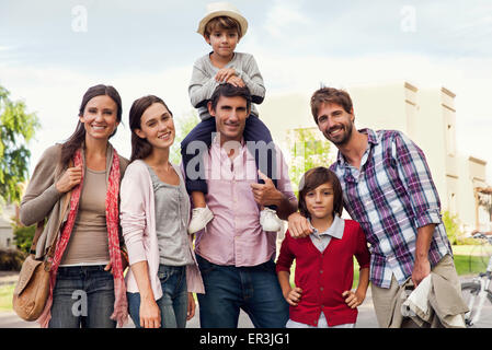 Family posing for group portrait outdoors - Stock Photo