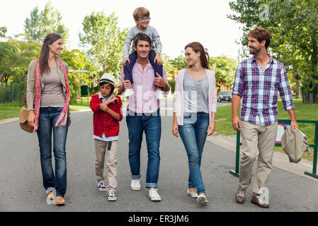 Family walking together in street - Stock Photo