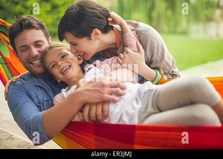 Family having fun together at home on the weekend - Stock Photo