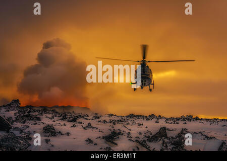 Helicopter flying by the volcano eruption at the Holuhraun Fissure, Bardarbunga Volcano, Iceland. - Stock Photo