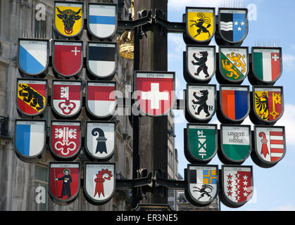 Cantonal Tree in Leicester Square London with coats of arms of 26 cantons of Switzerland - Stock Photo