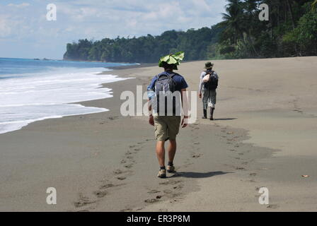 Trekking along the beach in the Corcovado National Park, Costa Rica - Stock Photo