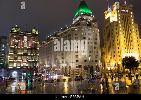 European style buildings along the Bund on a rainy night in Shanghai China - Stock Photo