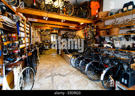 Old fashioned bicycle repair shop in Amersfoort, The Netherlands - Stock Photo