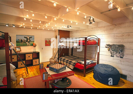 Interior detail. of children's room with bunk beds. Vermont dairy barn renovated into a unique home. - Stock Photo