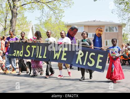 African American youth marching at the May Day parade in Minneapolis, Minnesota. - Stock Photo