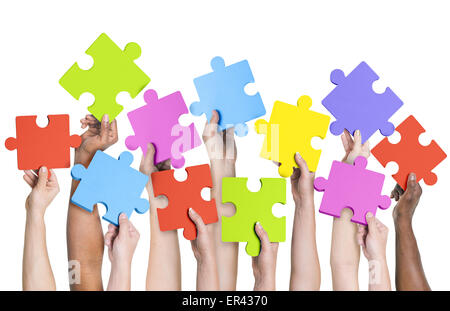 Human hands holding jigsaw puzzle. - Stock Photo