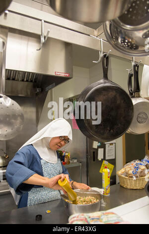 Virginia Dale, Colorado - Sister Maria Josepha prepares food in the kitchen of the Abbey of St. Walburga. - Stock Photo