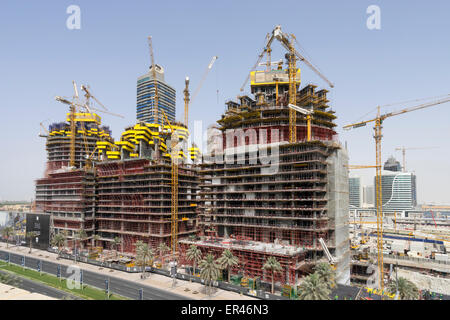 Three new luxury apartment towers under construction in Downtown district of Dubai United Arab Emirates - Stock Photo