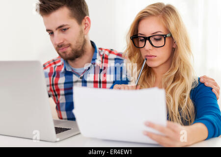 Focus couple and home finances - Stock Photo