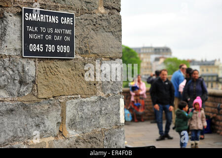 A Samaritans sign with a suicide helpline phone number on the edge of the Clifton Suspension Bridge in Bristol. - Stock Photo