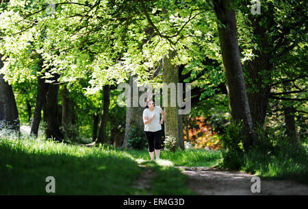 Brighton UK 27th May 2015 - A young woman out running in Preston Park Brighton early this morning in hot sunny weather - Stock Photo