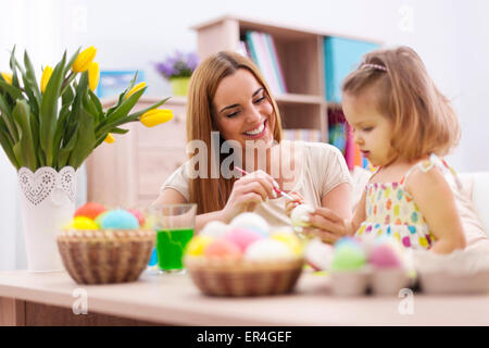 Loving family in easter holiday painting eggs. Debica, Poland - Stock Photo