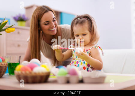 Family playing during painting easter eggs. Debica, Poland - Stock Photo