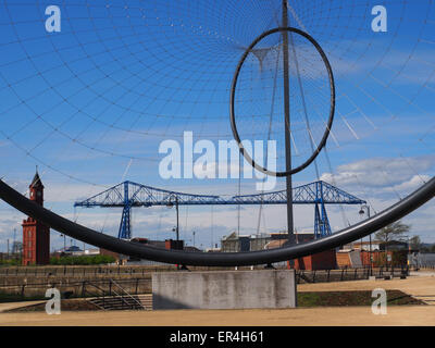 A modern sculpture at the quayside in Middlesbrough, England, with the Transporter Bridge visible in the background. - Stock Photo