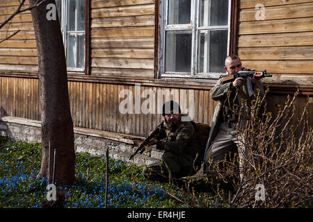 Hunting men are hiding in the bushes - Stock Photo