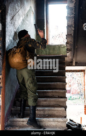 Professional combatant captured in the ruined house - Stock Photo