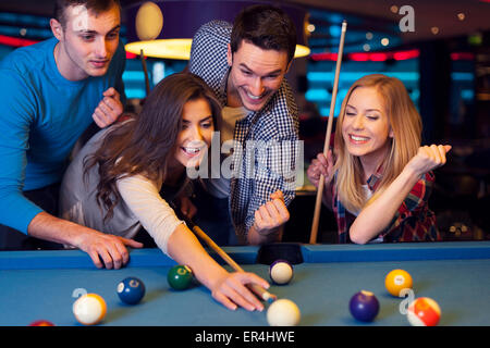 Friends hanging out at the pool bar - Stock Photo