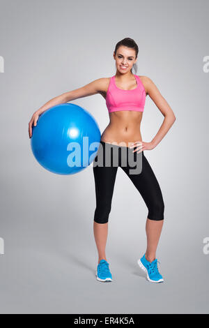 Smiling woman is ready for a full body workout. Debica, Poland - Stock Photo