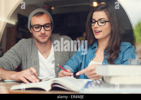 Hipster young couple studying together at cafe. Krakow, Poland - Stock Photo