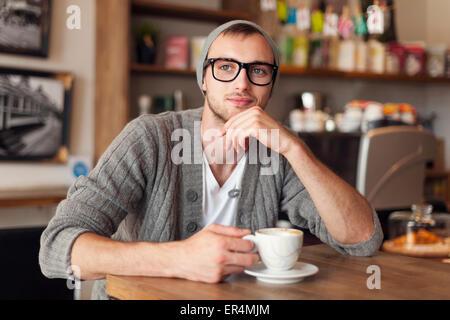 Portrait of stylish man at cafe. Krakow, Poland - Stock Photo