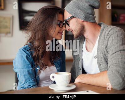 Portrait of loving couple at cafe. Krakow, Poland - Stock Photo