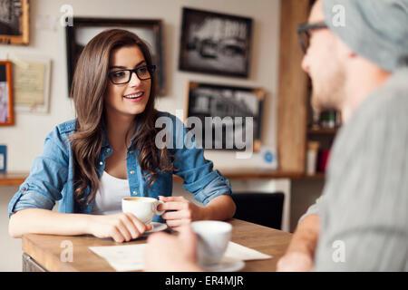 Stylish couple talking at cafe. Krakow, Poland - Stock Photo
