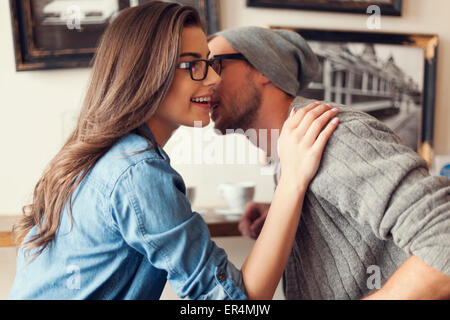 Romantic moments for hipster couple at cafe. Krakow, Poland - Stock Photo