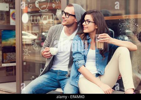 Portrait of stylish couple at outside of cafe. Krakow, Poland - Stock Photo